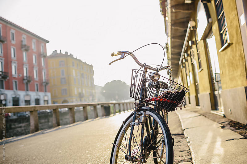 Bicycle parked along canals of Milan by michela ravasio for Stocksy United