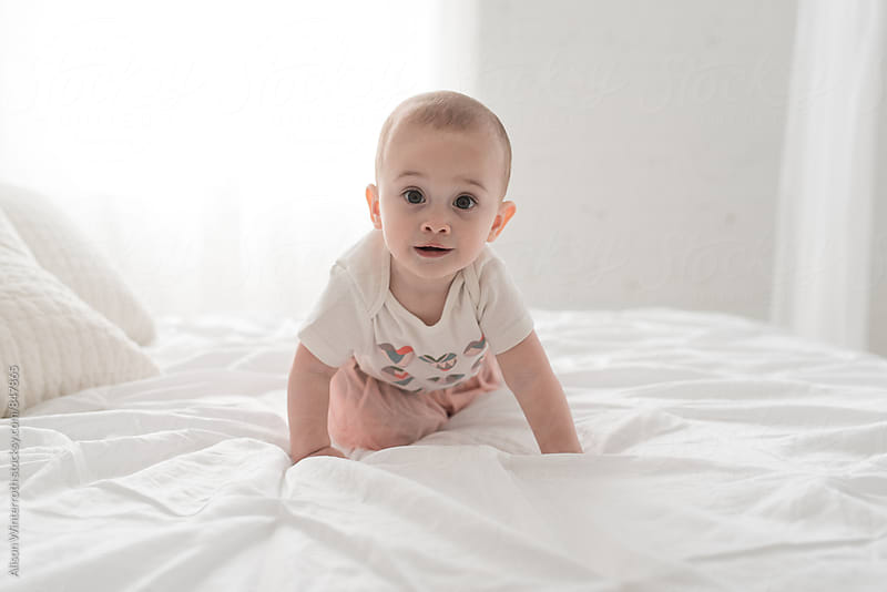 A Sweet Baby Girl Looking At The Camera by Alison Winterroth for Stocksy United
