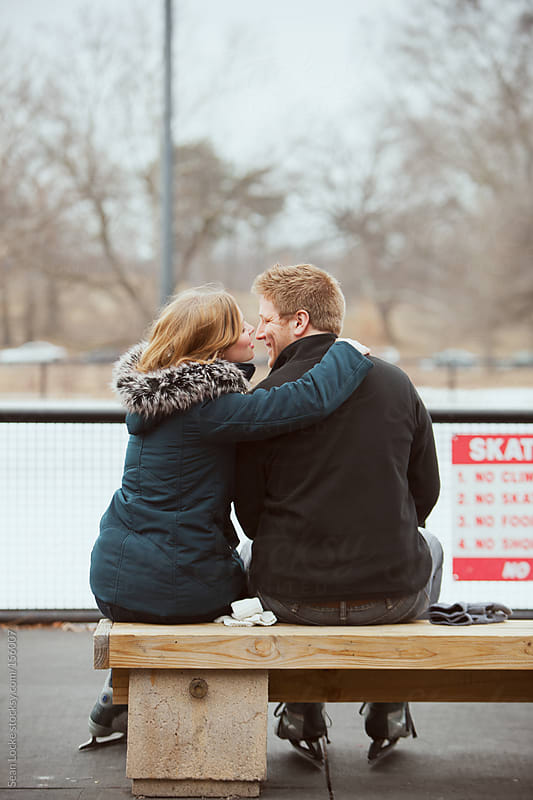 Skating: Stealing a Kiss to Keep Warm by Sean Locke for Stocksy United