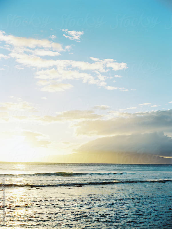 sunset over ocean off maui with blue sky and sea by wendy laurel for Stocksy United