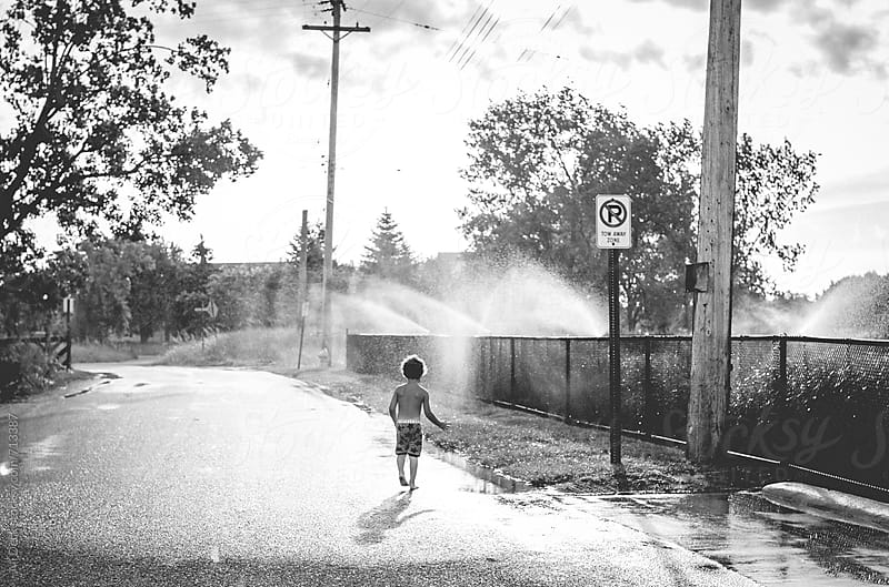 Toddler and Sprinkler by Ali Deck for Stocksy United