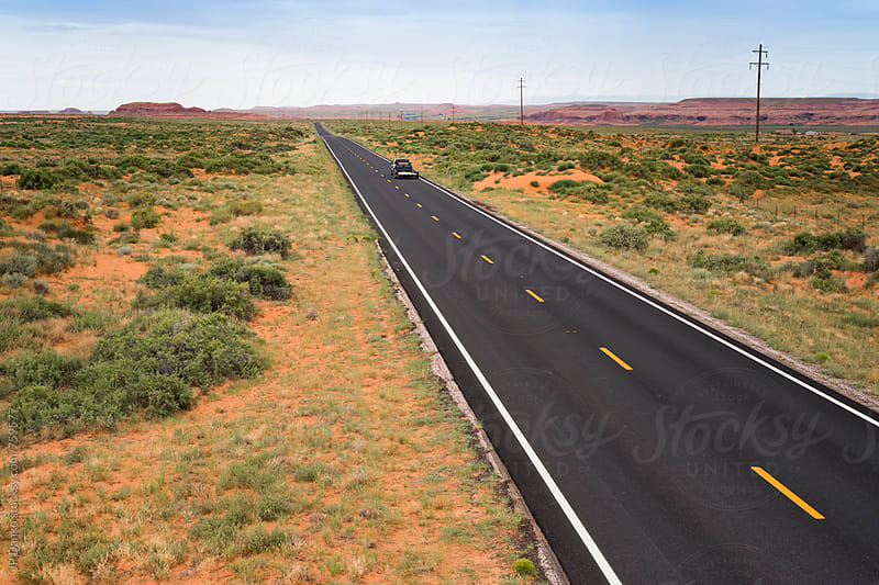 Remote Newly Paved Asphalt Highway Extending to the Horizon in Arizona by JP Danko for Stocksy United