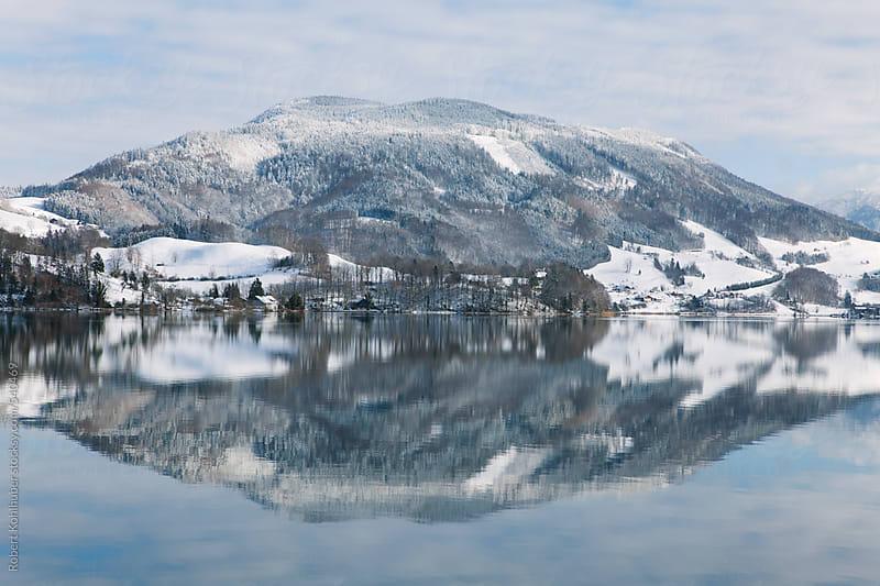 Winter landscape with mountain reflection near Mondsee, Salzburg, austria by Robert Kohlhuber for Stocksy United