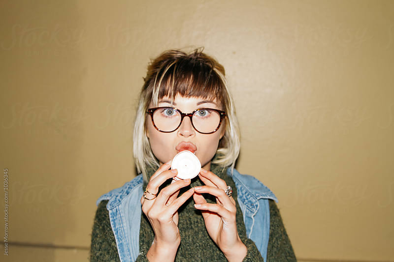 teen eats roll of gum tape  by Jesse Morrow for Stocksy United