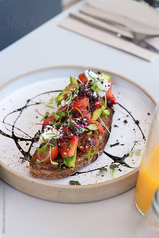 breakfast bruschetta with tomato, avocado, capsicum, feta and po by Gillian Vann for Stocksy United