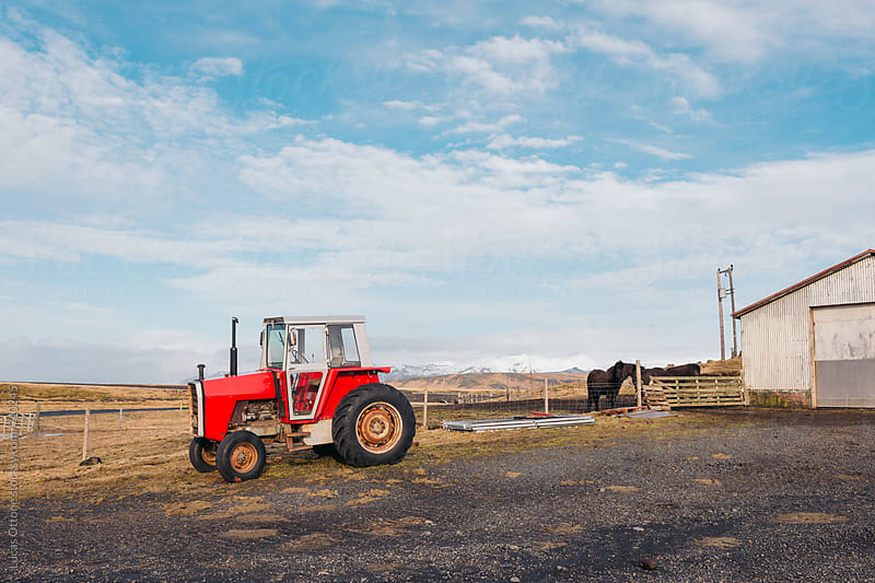 A tractor in rural Iceland by Lucas Ottone for Stocksy United