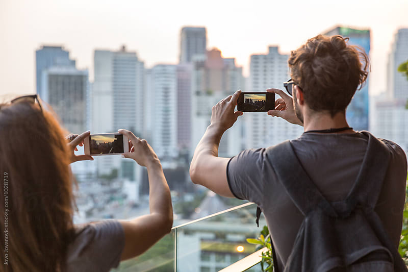 Couple on a date - taking a photo of a city view by Jovo Jovanovic for Stocksy United