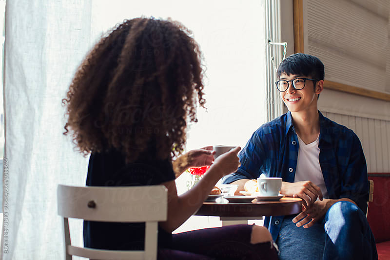 Trendy couple having breakfast in a coffee shop. by BONNINSTUDIO for Stocksy United