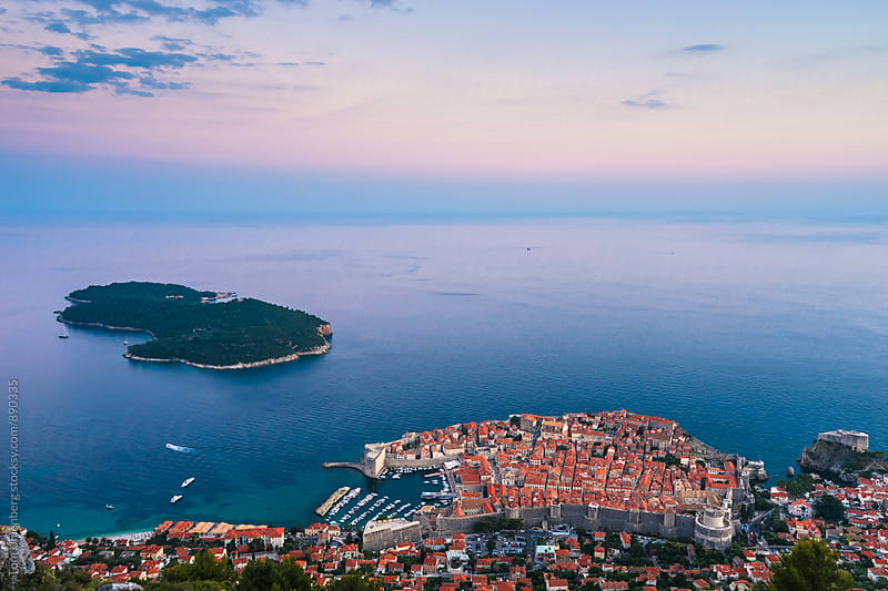Dubrovnik, Croatia - Elevated View of the Old Town and the Island of Lokrum at Dusk by Tom Uhlenberg for Stocksy United