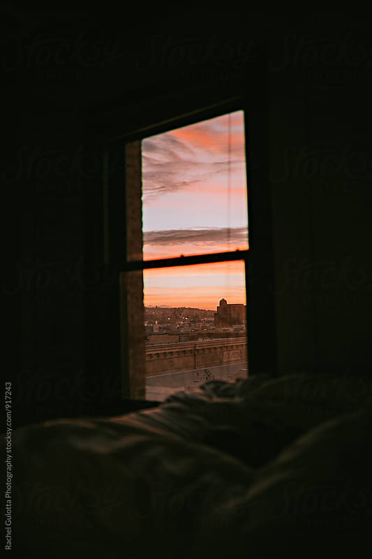 Sunrise or Sunset through an Apartment Bedroom Window by Rachel Gulotta Photography for Stocksy United