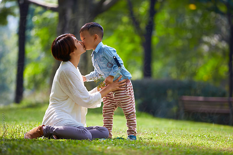 happy little boy with his mother in the sunny park by Bo Bo for Stocksy United