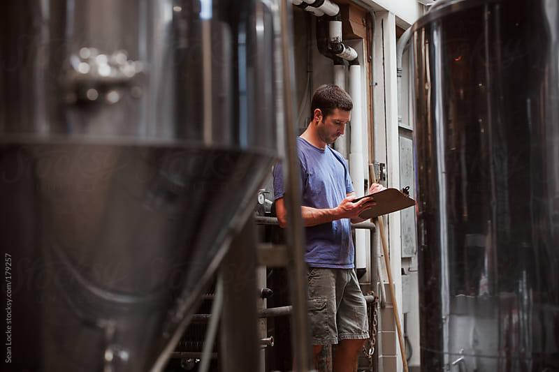 Beer: Brewer Tracks Efforts On Clipboard by Sean Locke for Stocksy United