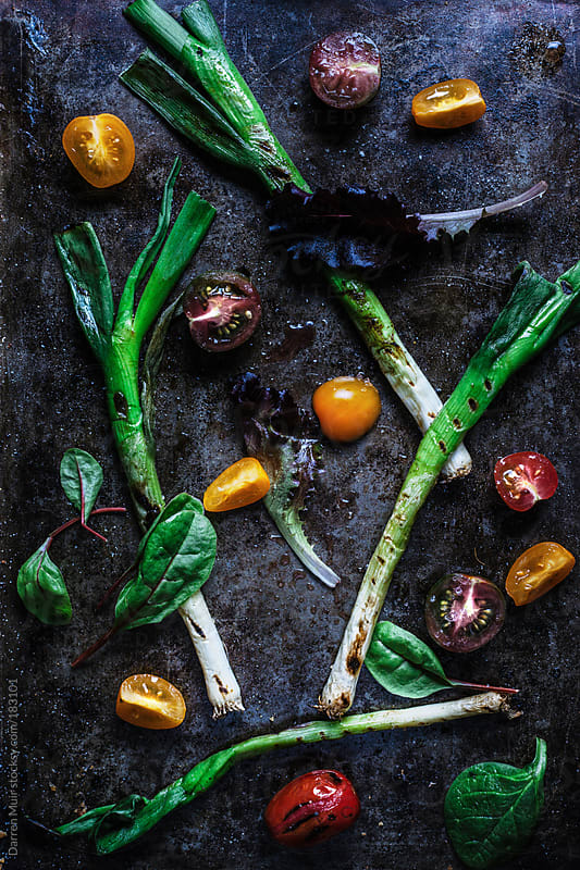 Grilled spring onion salad. by Darren Muir for Stocksy United