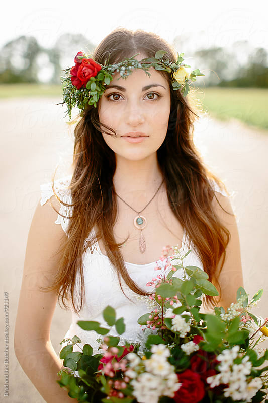 Bride in Floral Crown by Brad and Jen Butcher for Stocksy United