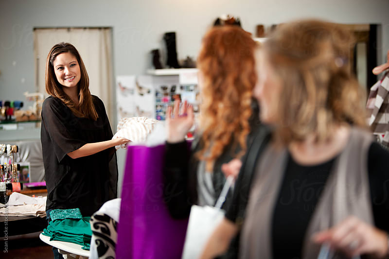 Boutique: Saleswoman Says Goodbye to Shoppers by Sean Locke for Stocksy United