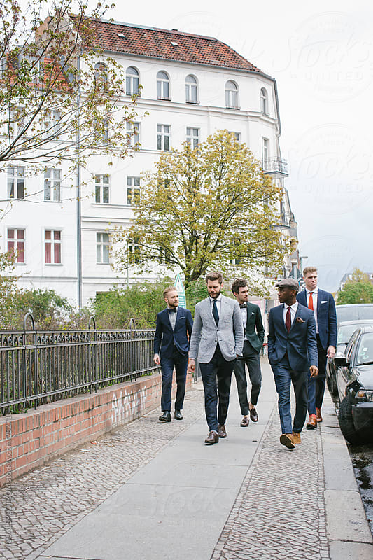 Five Handsome Young Men in Suits Walking Down Sidewalk in City by Julien L. Balmer for Stocksy United