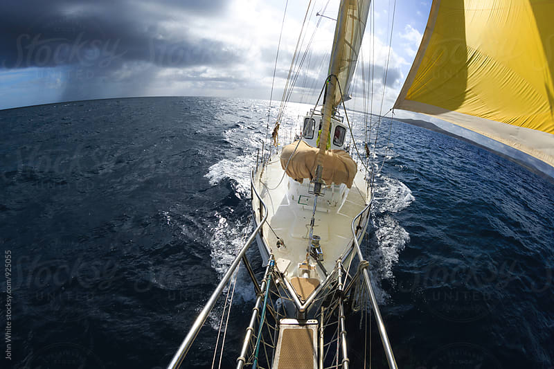Yacht sailing and storm clouds. by John White for Stocksy United
