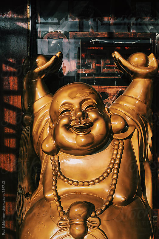 chubby happy buddha by Paul Schlemmer for Stocksy United