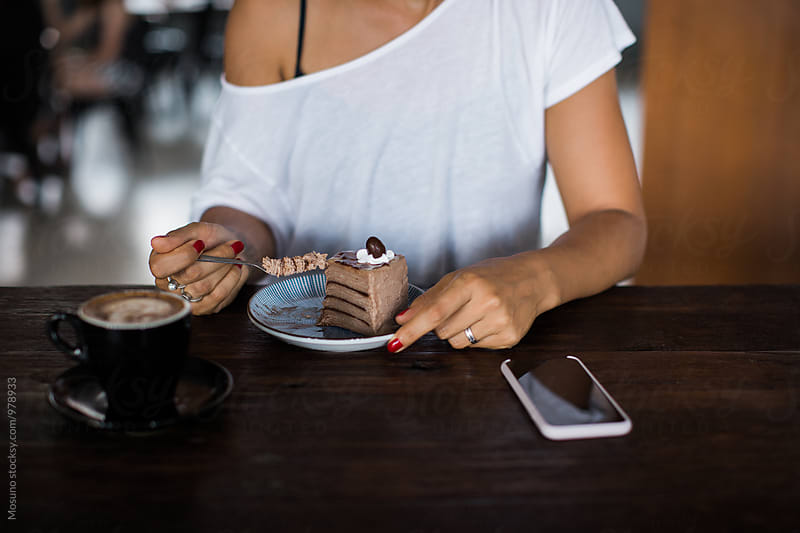 Woman Eating Chocolate Cake by Mosuno for Stocksy United