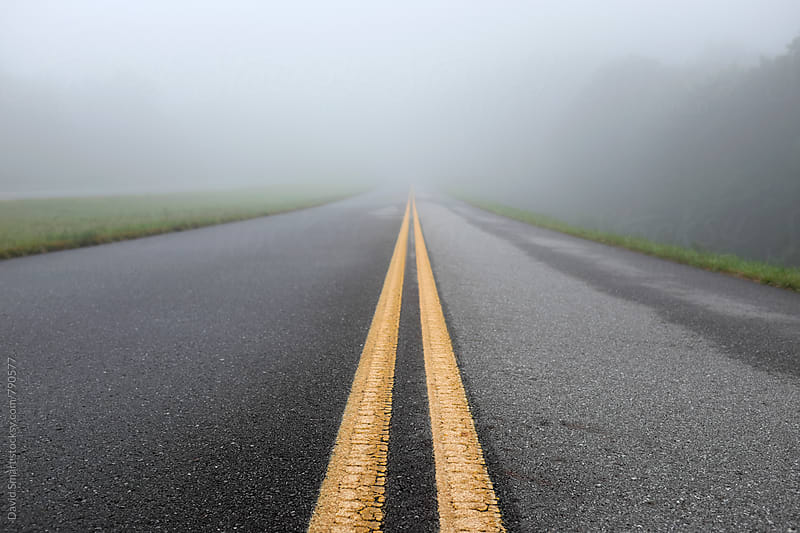 Fog shrouded roadway from low angle view by David Smart for Stocksy United