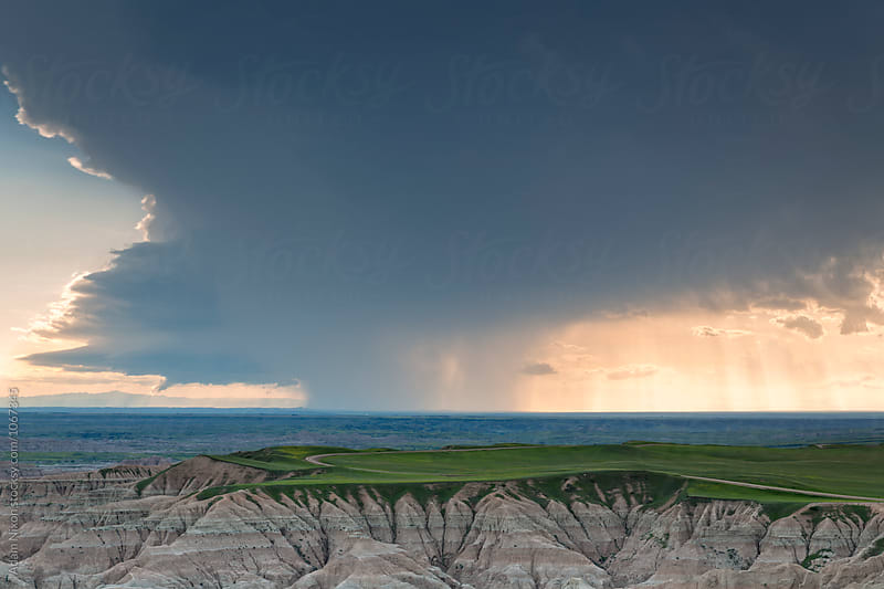 Storm clouds over Badlands National, South Dakota by Adam Nixon for Stocksy United