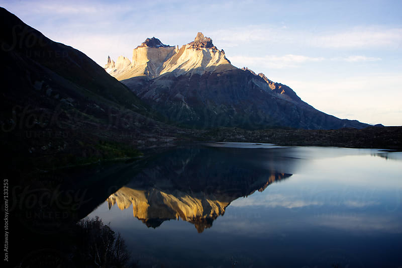 Mountain reflection by Jon Attaway for Stocksy United