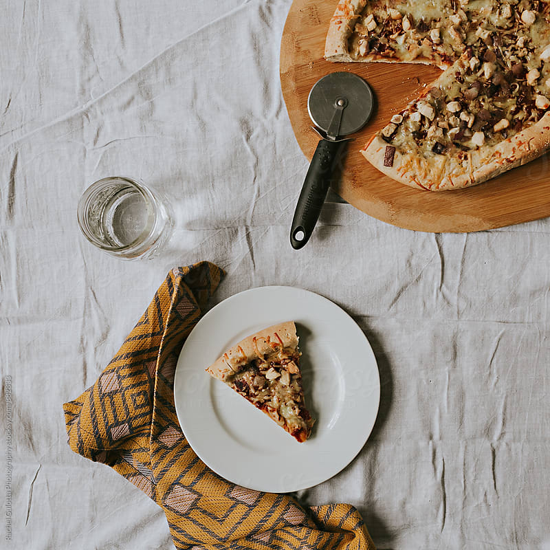 A Slice of Pizza on a Table by Rachel Gulotta Photography for Stocksy United