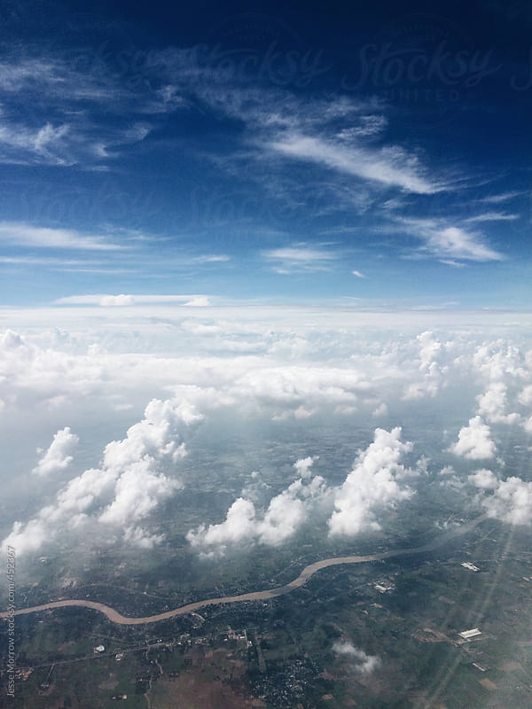 View out of window of airplane during travel by Jesse Morrow for Stocksy United