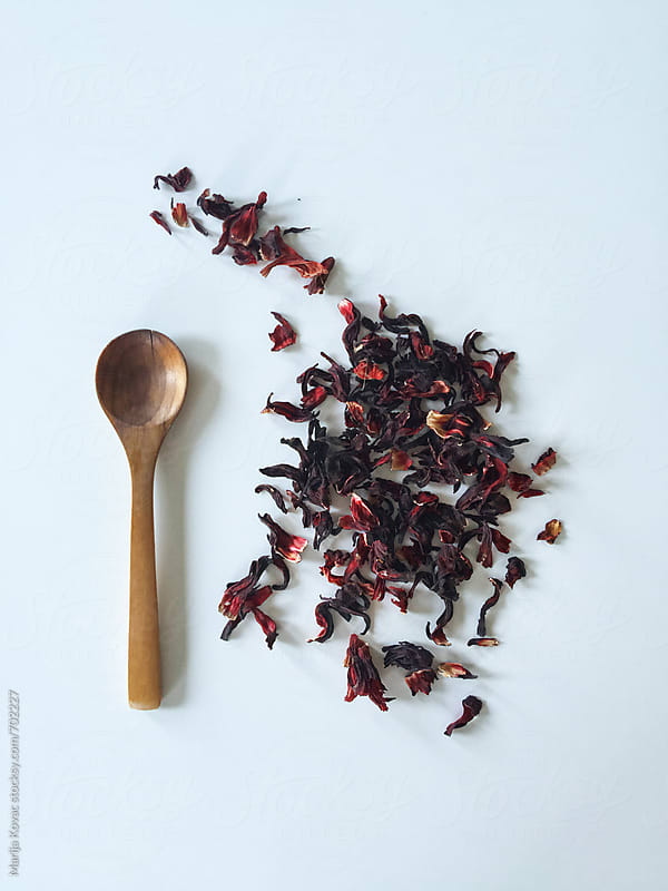 Hibiscus tea and wooden spoon by Marija Kovac for Stocksy United