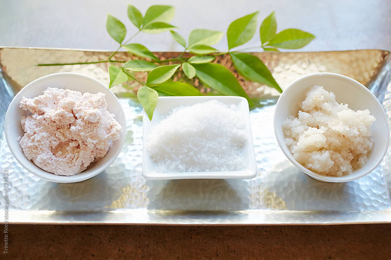 Spa still life of salt and sugar scrub products by Trinette Reed for Stocksy United