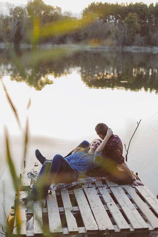 Couple by the lake by Dejan Ristovski for Stocksy United