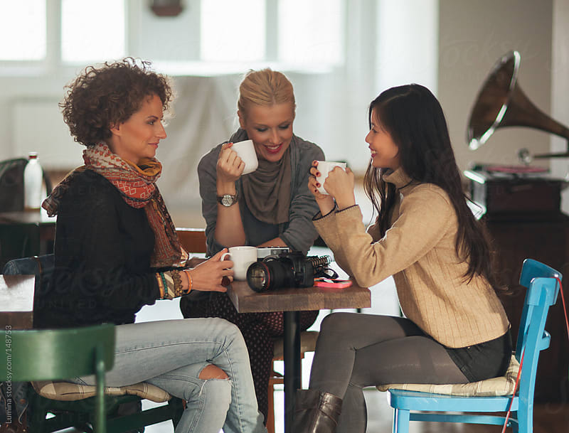 Friends Drinking Coffee at a Cafe by Lumina for Stocksy United