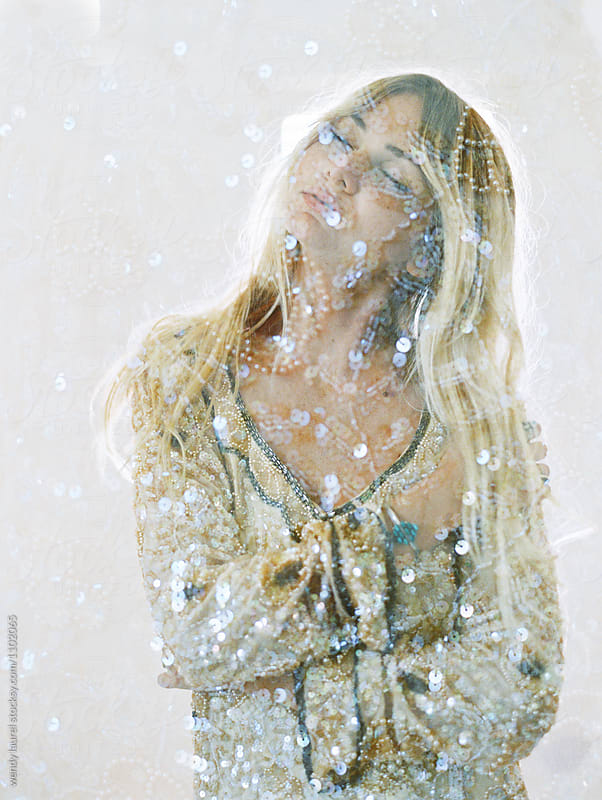 double exposure of blonde with glitter by wendy laurel for Stocksy United