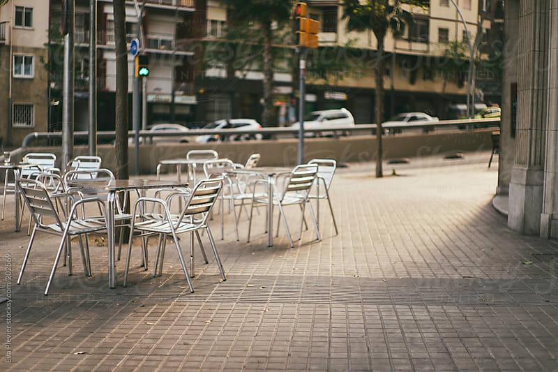 Empty street terrace. by Eva Plevier for Stocksy United