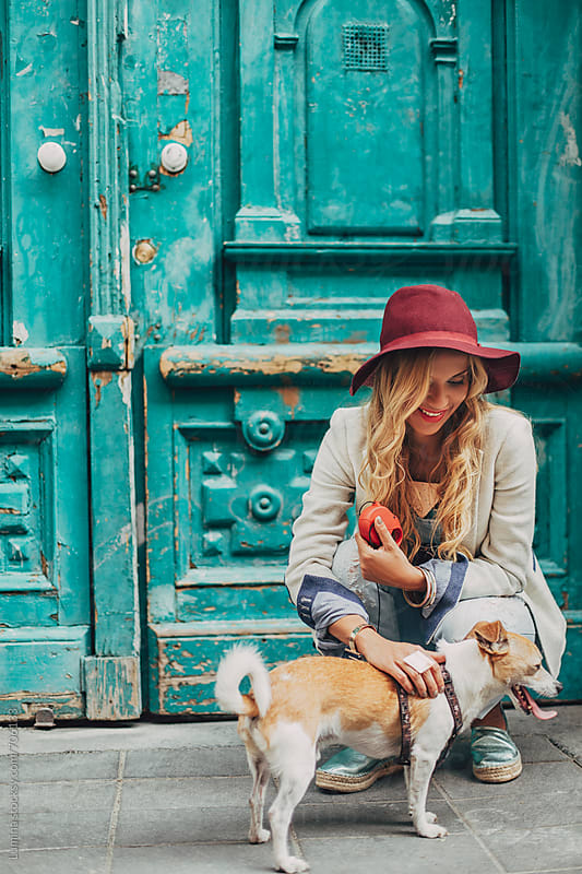 Stylish Blonde Woman With a Dog by Lumina for Stocksy United