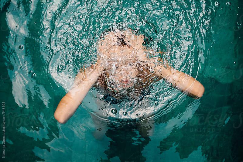Tanned Caucasian Woman Underwater by Nemanja Glumac for Stocksy United