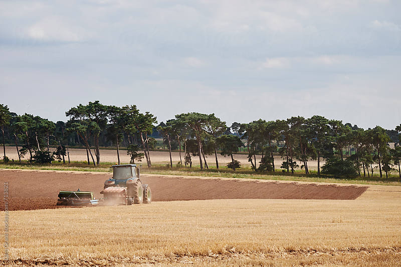 Tractor ploughing a stubble field. Norfolk, UK by Liam Grant for Stocksy United
