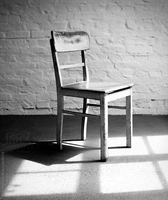 Empty chair  in a loft with window light. by W2 Photography for Stocksy United