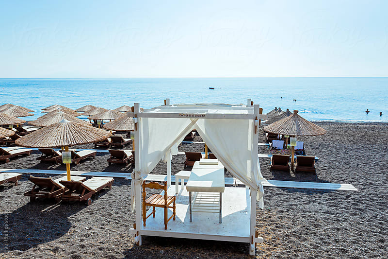 Massage table on a beach in Kamari, Santorini, Greece by Paul Phillips for Stocksy United