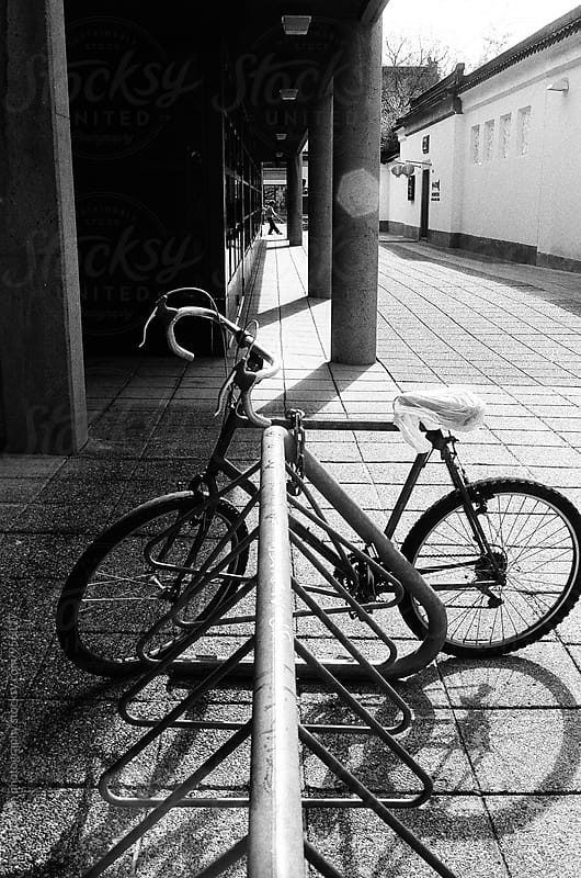 a bike on the street by Kirill Bordon photography for Stocksy United