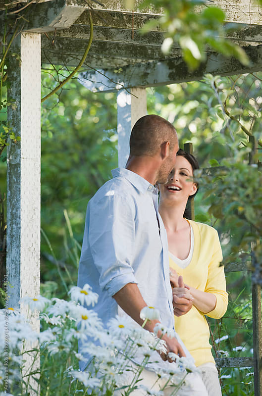 Happy couple in garden by Andersen Ross Photography for Stocksy United