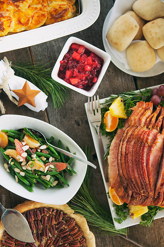 Christmas: Dinner Features Glazed Ham And Pecan Pie For Dessert by Sean Locke for Stocksy United