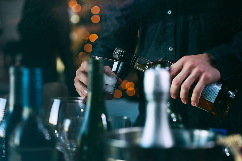 NYE: Man Pouring Party Drink From Bottle by Sean Locke for Stocksy United