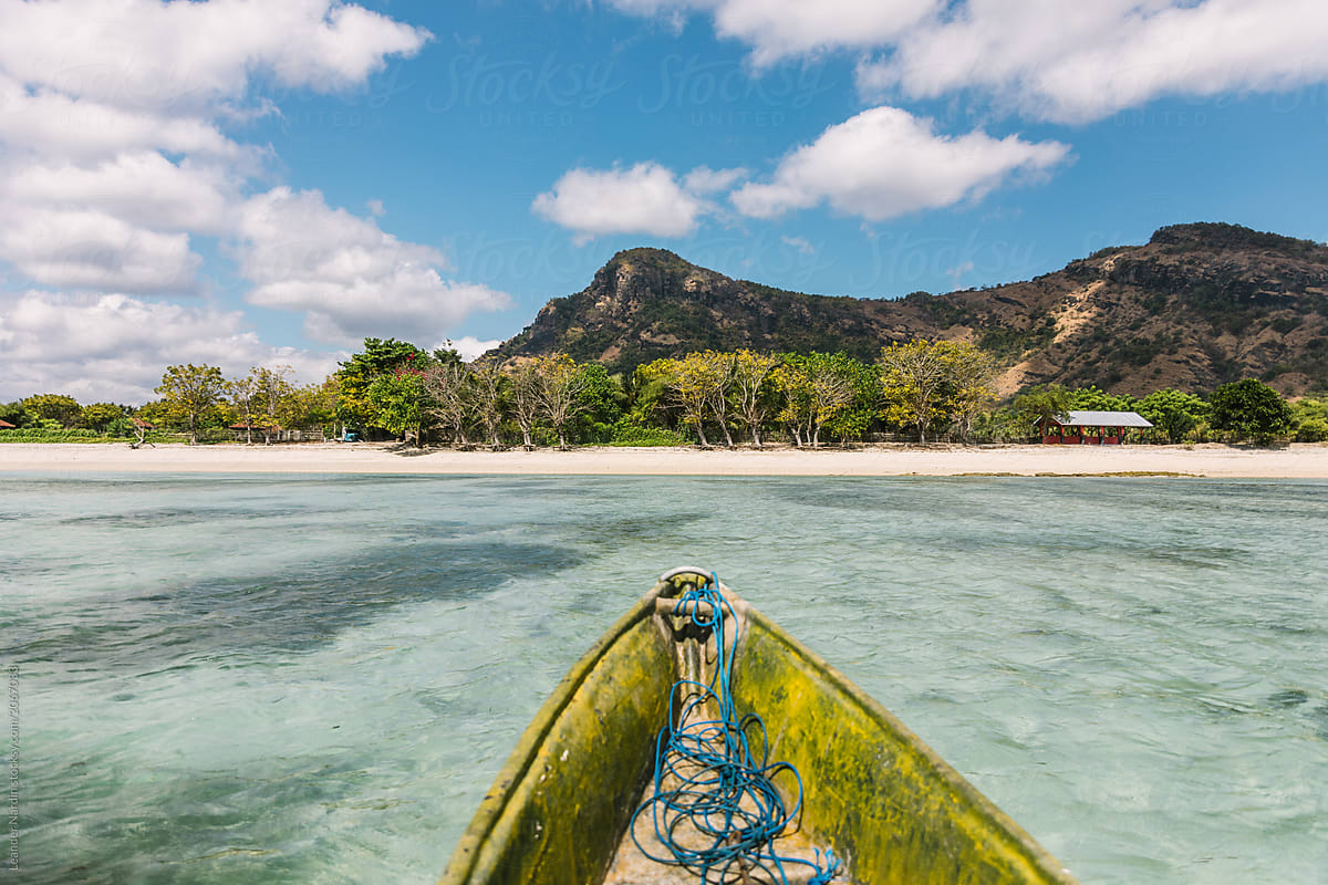 Detail Of Fishing Boat In Crystal Clear Water At The Coast Of A Tropical Island By