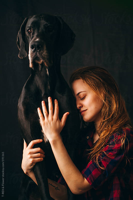 Redhead young woman embraces her dog by Danil Nevsky for Stocksy United