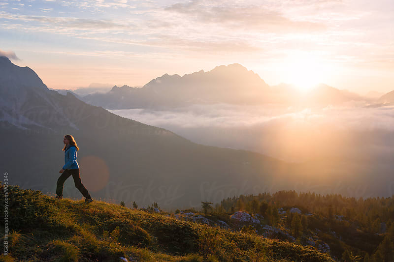 Young woman hiking at sunrise by RG&B Images for Stocksy United