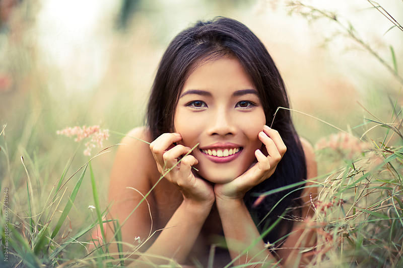 Cute Asian woman portrait enjoying in the nature by Nabi Tang for Stocksy United