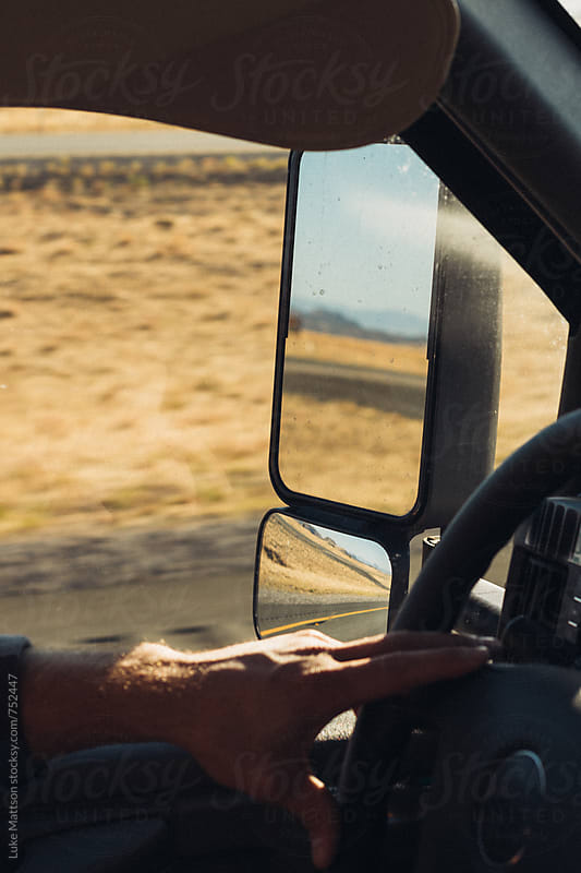 Reflection Of Desert Road In Sideview Mirror Of Truck by Luke Mattson for Stocksy United