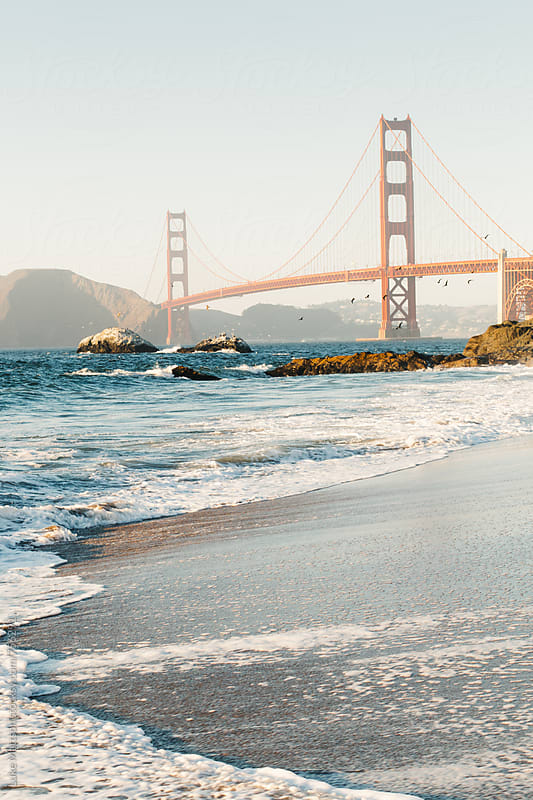 View Of Golden Gate Bridge From Shore Of Baker Beach by Luke Mattson for Stocksy United