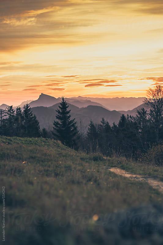 Sunrise in the austrian alps by Leander Nardin for Stocksy United